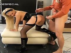 Nasty blonde in black pissing and getting fucked