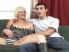 Transsexual Isla fucks a guy in his ass on a sofa