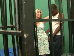 Tattooed blonde rides big black cock in a prison cell tube porn video
