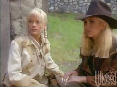 Blonde babes in cowboy clothes toy their asses and pussies