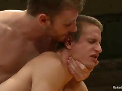 Two oiled up wrestlers are in a gay sex