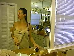Wet-haired chick gets her shaved cunt fucked in the bathroom