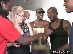 Interracial Gangbang Featuring a White Girl with Glasses