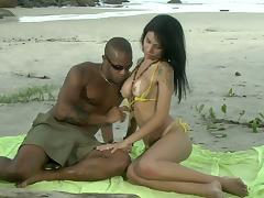 Monica Mattos gets ass fucked on a beach in an interracial sex scene