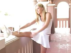 Gorgeous solo model in tennis outfit shows her pussy