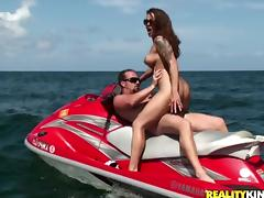 Sexy brunette Krystal Main rides a cock in the middle of a bay