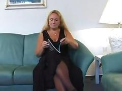 chunky blond granny disrobes and masturbates with cell phone tube porn video