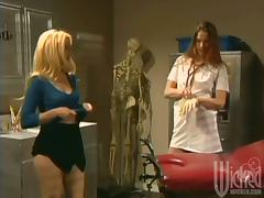 Cute blonde babe gets toyed by a doctress in a hospital