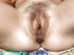 Fingering my wet hairy pussy in the hot sun