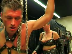 Guy bound with chains, spanked and cock tortured