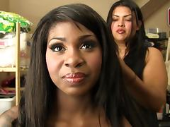 A very sexy ebony is getting her hair done for porn
