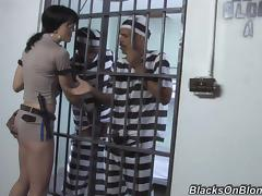Sexy and bitchy prison guard entertains two convicts