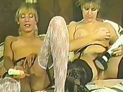 Two retro chicks in stockings get nailed by two men