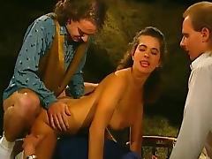 Sweet brunette is fucking with two dicks