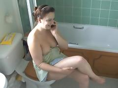 Busty babe Jenny is talking on the phone