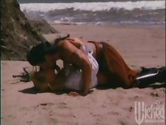 A super hot blond is having sex on the beach