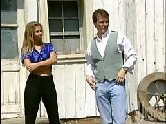 A redhead girl gets fucked and fingered in a saloon