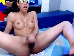Tranny jerks her cock off till she cums