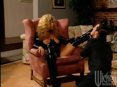 A curly blonde in leather lingerie rides a cock passionately