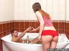 A very juicy teen is getting anal fuck in the bathroom