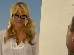 A blonde MILF in glasses gets fucked by a painter