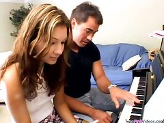 Private piano lesson ends up with a hot doggy style tube porn video