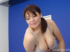 A sporty Japanese girl with big boobs gives a titjob in a gym tube porn video