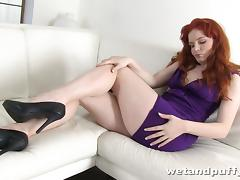 Charming and horny redhead is having some fun