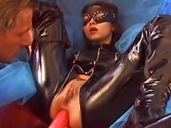 Sweet babe in latex is banging in her anal hole