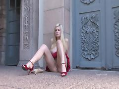 Danielle enjoys rubbing her shaved pussy with a dildo outdoors