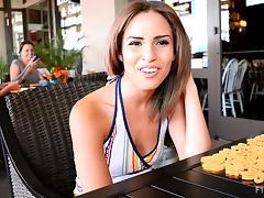 Beautiful Natasha talks on camera in a restaurant