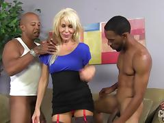Sexy blonde cougar Erica Lauren enjoys interracial MMF sex