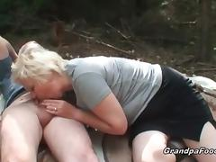 Tanned slut and granny slut are sucking big cock