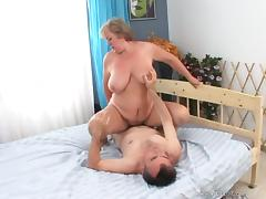 Mature fat blonde gives a blowjob and jumps on a cock tube porn video