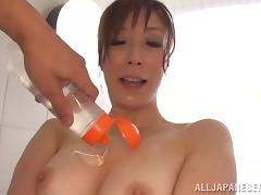 A playful Japanese MILF gets oiled up and fucked in a bathroom
