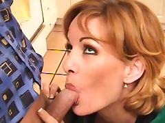 Slender short-haired milf is sucking a dick
