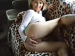 A cougar plays with her pussy and rides a dick in a homemade video
