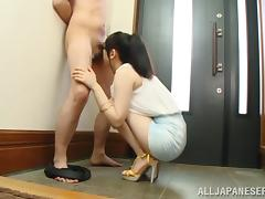 Clad Japanese cutie sucks a small prick in the hallway