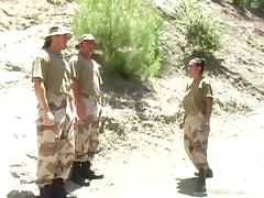 A girl in a military uniform gets banged by two fellow servicemen