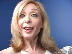 Mature blonde Nina Hartley gives BBC-sucking tutorial in gloryhole vid tube porn video