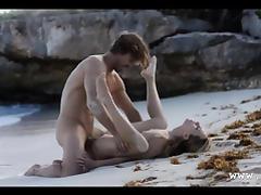 sleek art sex of horny couple on beach