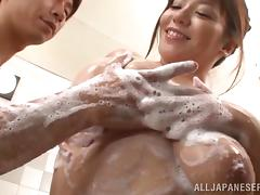 having fun during shower time for an asian couple