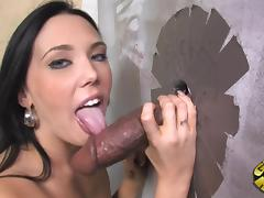 Super hot brunette is blowing a huge black cock
