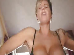 Busty milf fucks a huge bottle and fisted till she squirts porn tube video