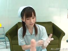 A cute Japanese nurse in gloves gives a handjob in a POV video