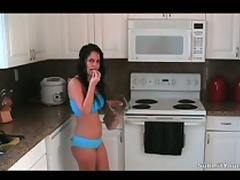 A brunette chick sucks and rides a dick in a kitchen
