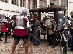 Two knights fuck a peasant woman in a wooden house