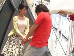 Japanese MILF rides and sucks a dick under the stairs
