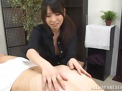 Helpful Japanese secretary gives hand to her exhausted boss