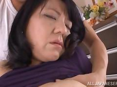 Japanese milf Emiko Ejima makes out with a guy and rides his boner